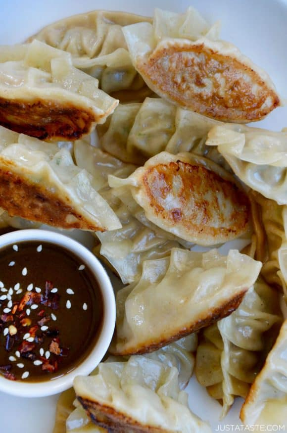 Closeup view of homemade Pork Potstickers with Citrus-Soy Dipping Sauce