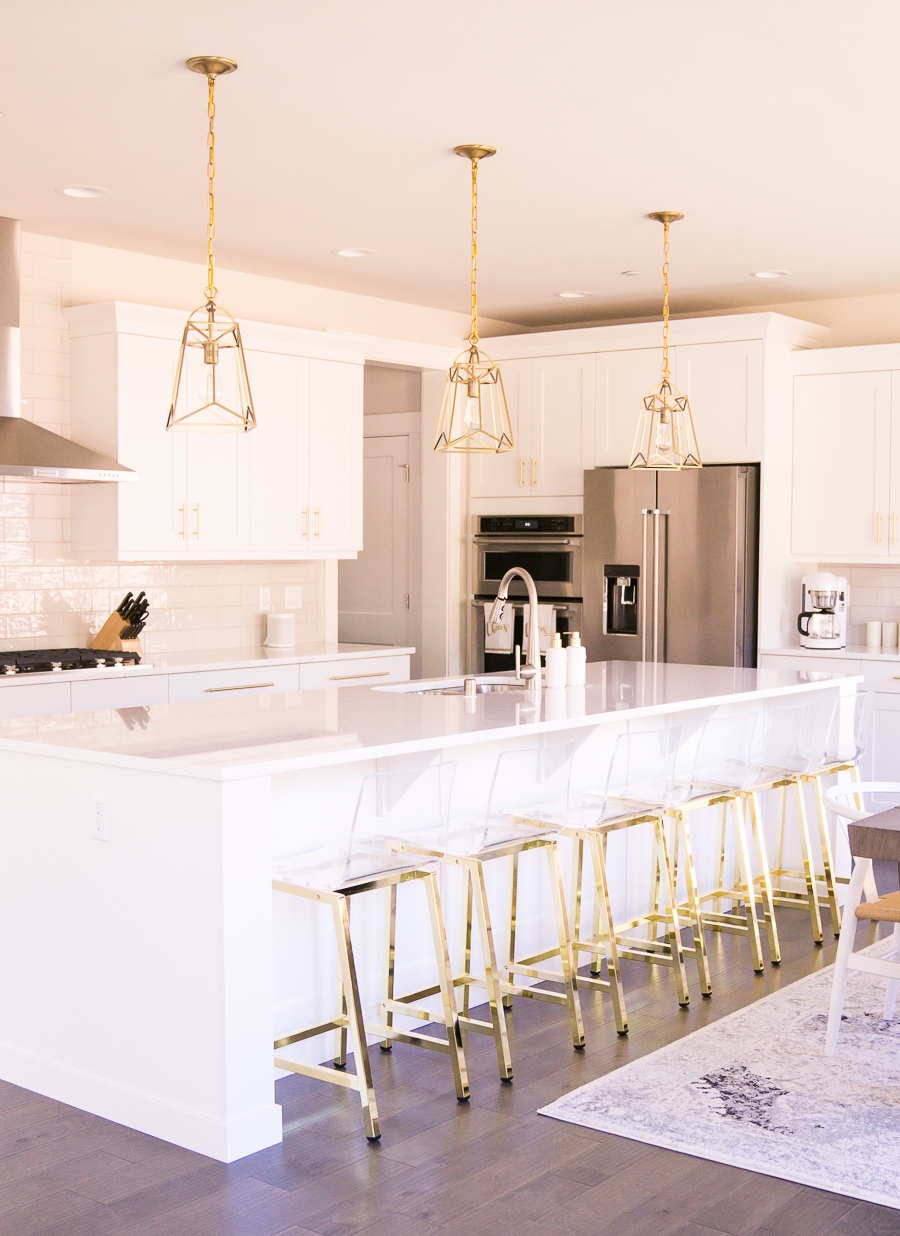 gold kitchen two level island white and lantern pendant lights acrylic bar stools with legs