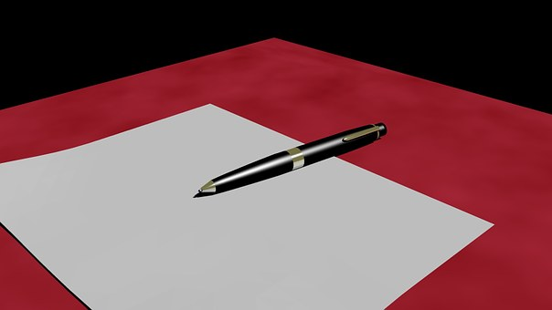 A piece of writing paper and a pen