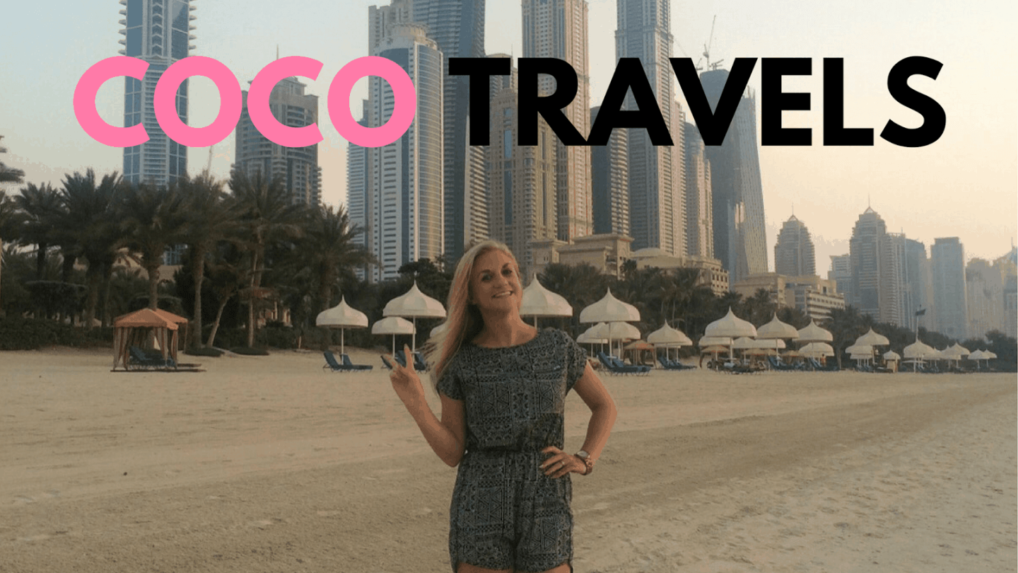 Sam on beach in a dress smiling with the words Coco Travels