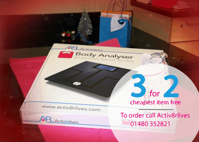 Boxed set of body analser scales with a 3 for 2 banner with phone number to call and purchase