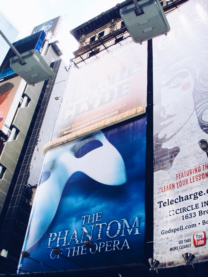 Billboards in Times Square, NYC, showing the Phantom of the Opera billboard