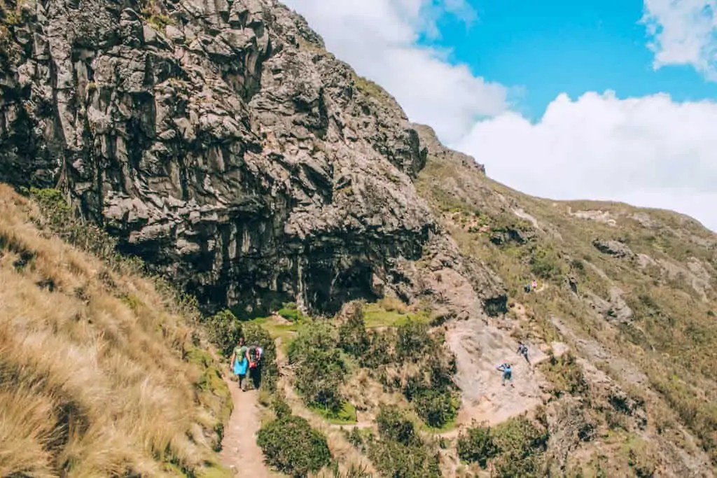 Climbing the rock face on the hike to Pichincha
