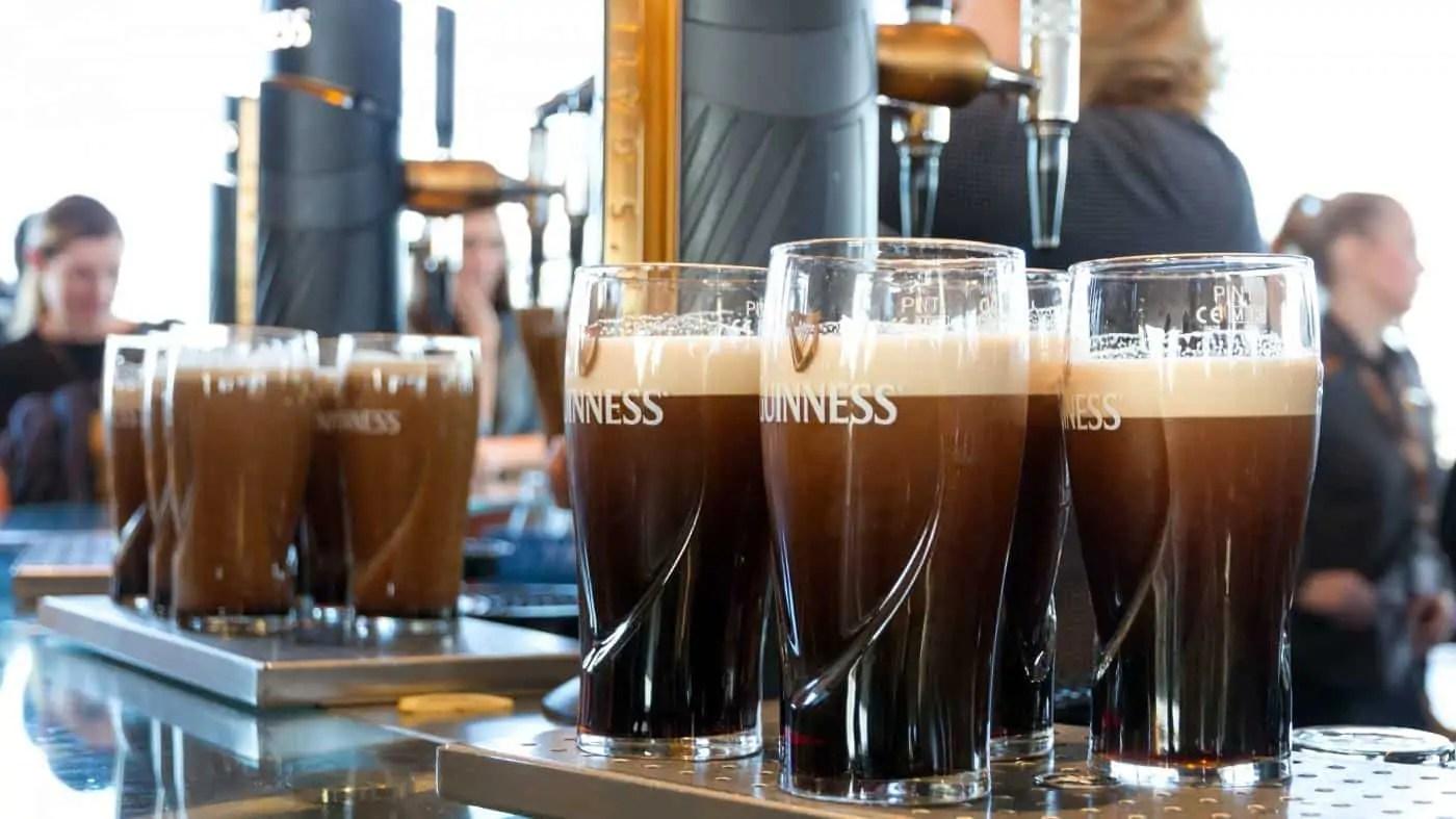 Glasses of Guinness in a bar