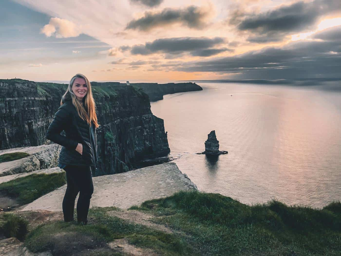 me standing in front of the Cliffs of Moher at sunset