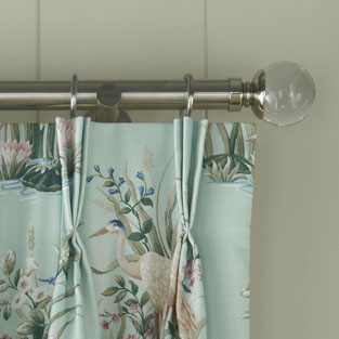 wooden or metal curtain poles just