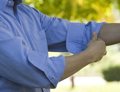 How to Roll Your Shirt Sleeves Without Compromising on Style