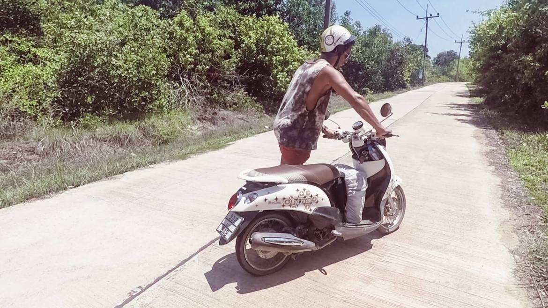 Woody walking with broken scooter bike in Koh Yao Yai Thailand
