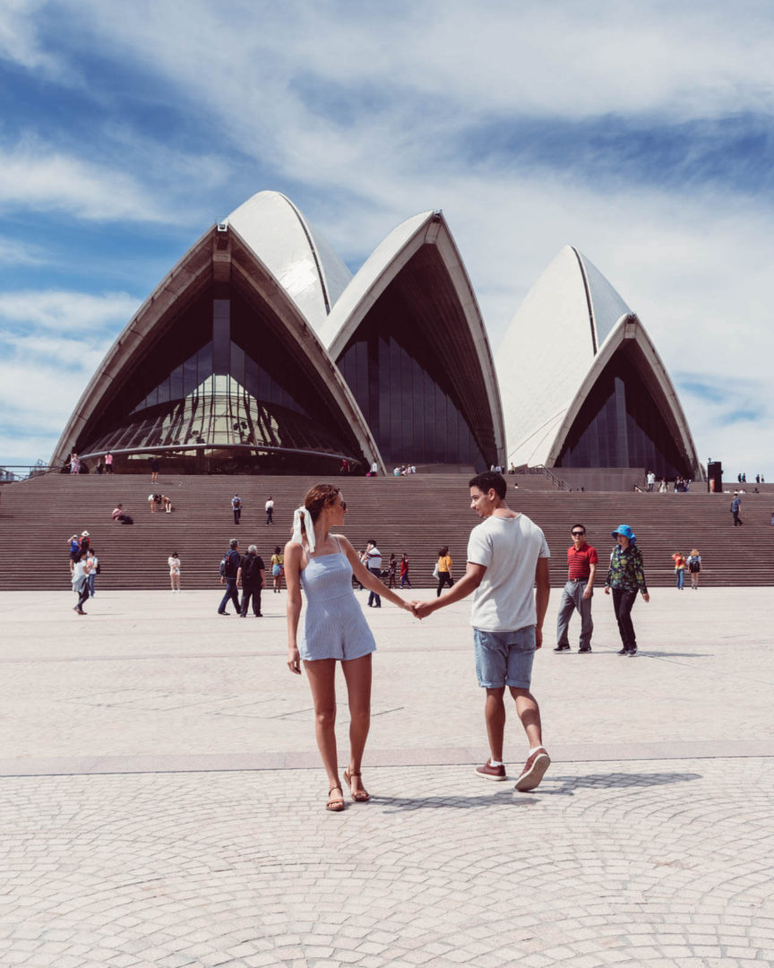 Couple posing outside sydney opera house
