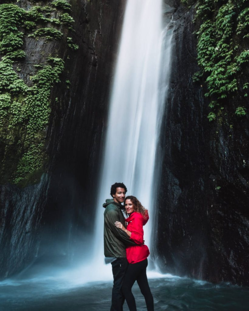 Couple smilling for a picture at Red Coral waterfall Munduk