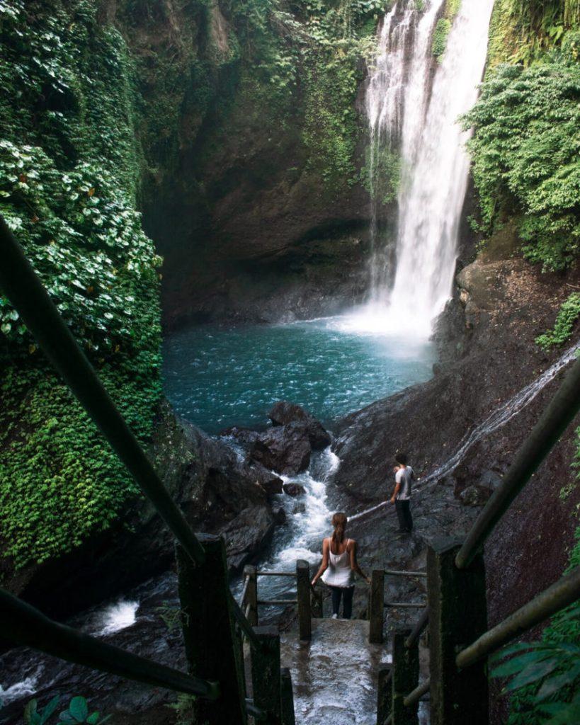 Couple infront of Aling Aling waterfall in Bali, Munduk