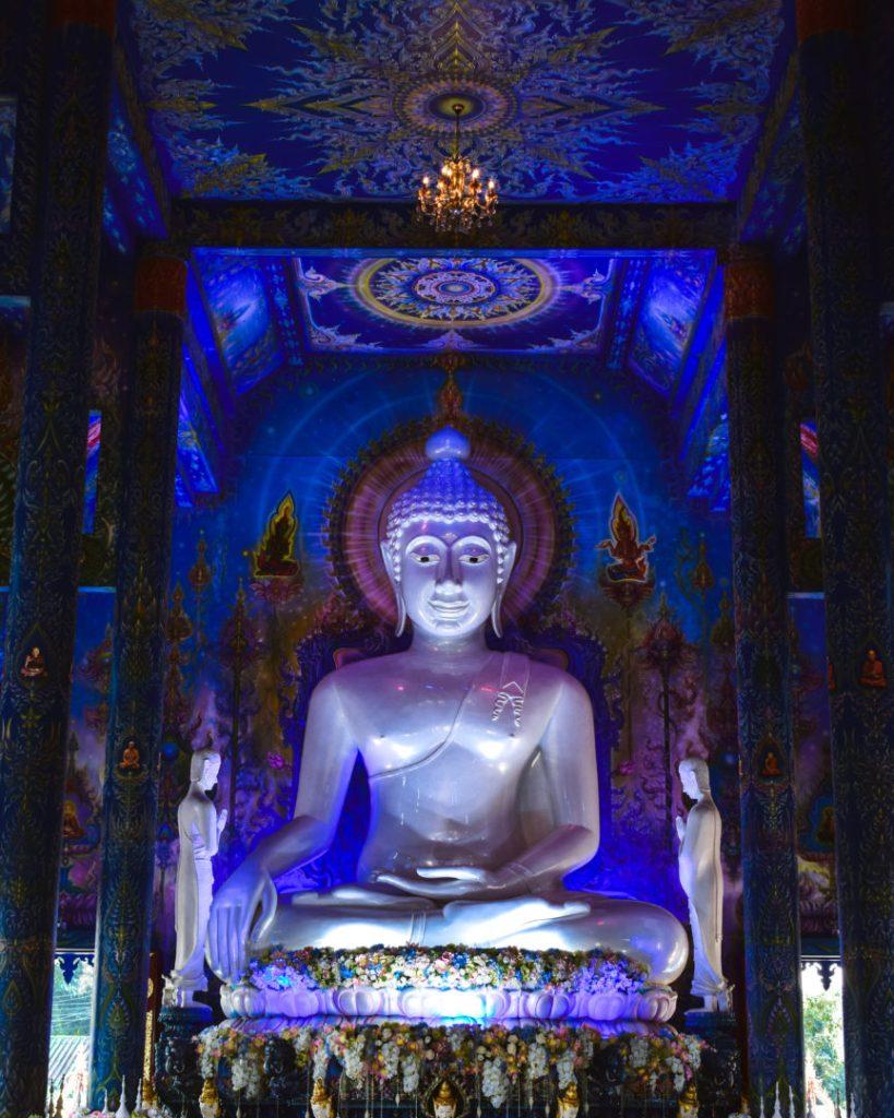 Buddha lit up in Chiang Rai Blue Temple
