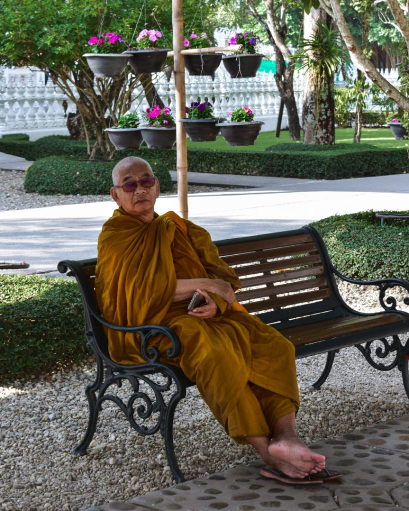 Monk resting at the white temple