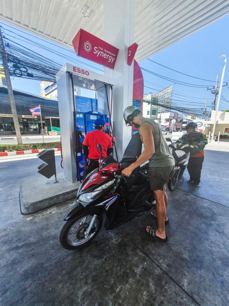 Buying petrol from a service station in phuket
