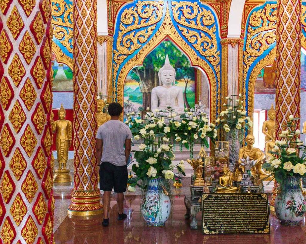 Martin walking admiring the golden walls and buddha