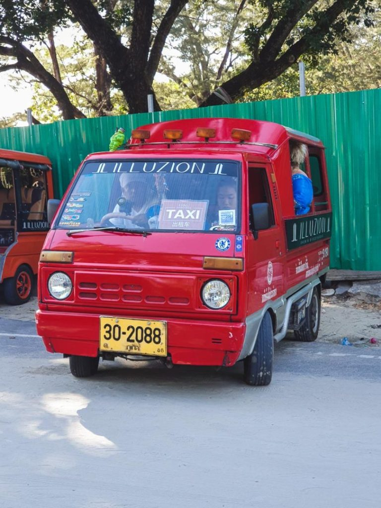 red songthaew in thailand