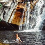Kerrie swimming in the waterfall pool at Emerald Creek Falls