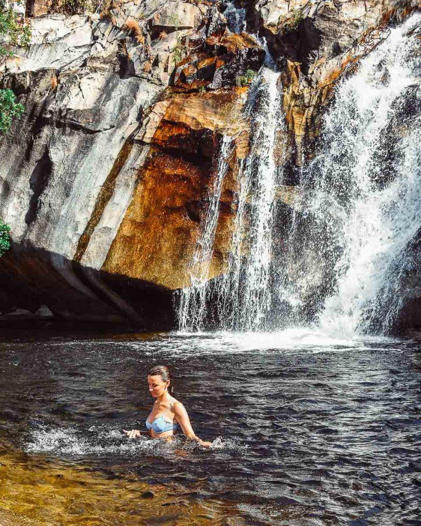 Kerrie swimming in the waterfall pool at Emerald Creek Falls