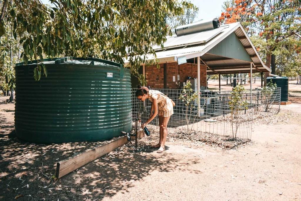 kerrie refilling water at water tank mareeba