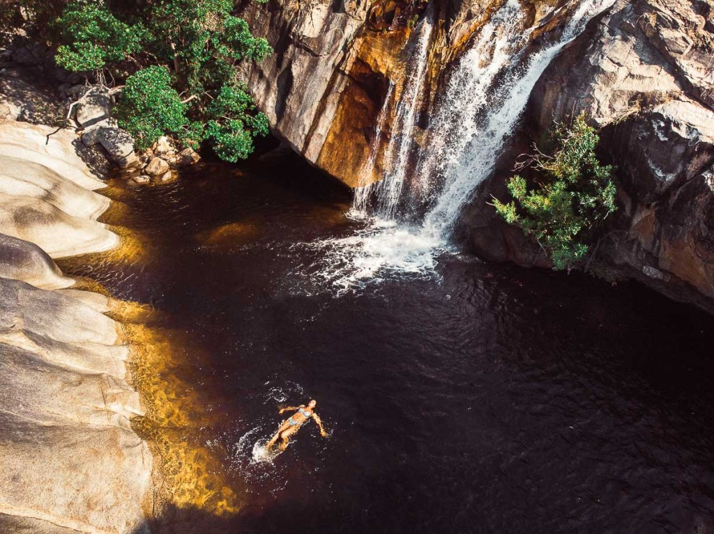 Swimming at Emerald Creek Falls in Queensland