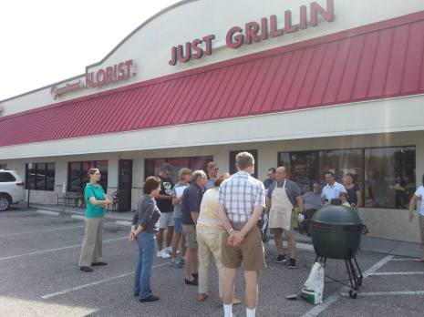 customers learning about grill