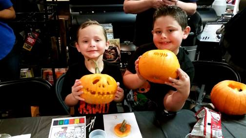 kids proud of pumpkin they carved