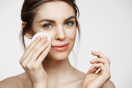 women applying skincare product
