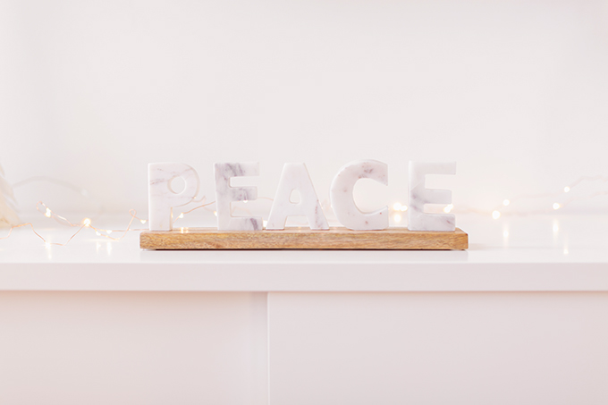 Apartment Friendly Modern Holiday Decor | Balsam & Fir Marble PEACE Sign | Bohemian, Mid Century Modern Holiday Decor | Bohemian Holiday Home Tour 2018 | Caramel Mid Century Modern Leather Couches // JustineCelina.com