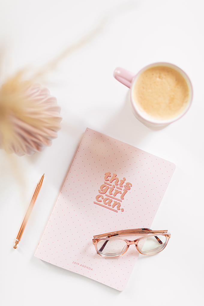 2018 Review + 2019 Goals | Calgary Lifestyle Blogger | 2019 Planning and Goal Setting | Entrepreneur Working from Home | HomeSense Fringe This Girl Can 2019 Agenda | Nespresso Coffee on a White Coffee Table | 2019 Motivational Goals Flatlay | Bonlook Lauren Blue Light Blocking Glasses In Peach // JustineCelina.com