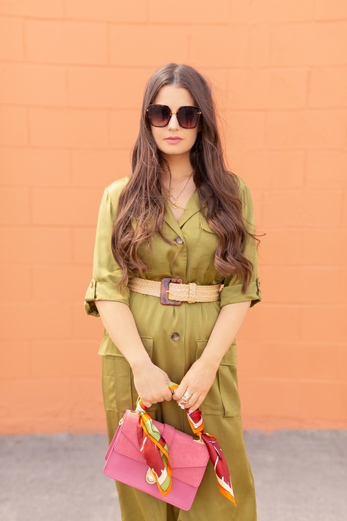 SPRING/SUMMER 2019 LOOKBOOK | Utilitarian Luxury: How to Style a the Utility Trend for Spring | Utility Cargo Outfit Ideas Spring 2019 | Professional Spring/Summer 2019 Outfits | Brunette woman wearing an Olive Green Satin Cargo Dress, raffia belt, nude pumps and pink handbag with a vintage scarf | How to Wear the Pantone SS19 Fashion Colour Trend Report | Top Spring/Summer 2019 Trends and how to wear them | Calgary Fashion Blogger // JustineCelina.com