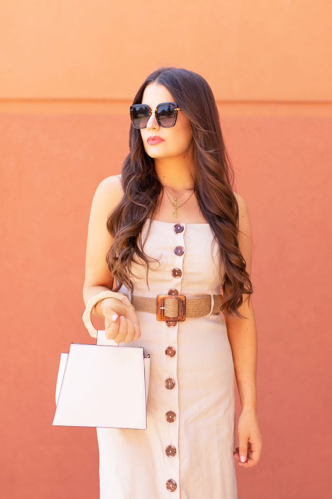LATE SUMMER 2019 LOOKBOOK | Power Dressing: How to Style a Button-Down Linen Dress for the Office | How to Style Linen Dresses into Fall | The Best Power Dresses for Work | Summer/Fall 2019 Professional Outfit Ideas | Brunette woman wearing a tan button-down linen dress, tortoise framed cat eye sunglasses, a woven tortoise buckle belt, and cream a wooden-handle bracelet bag with nude d'orsay pumps | Top Summer to Fall 2019 Transitional Trends | Calgary Fashion Blogger // JustineCelina.com