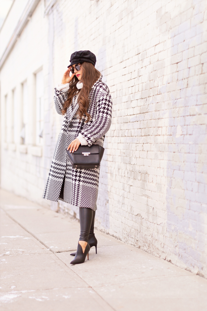 Autumn / Winter 2019 Lookbook: Houndstooth Chic | Top Fall / Winter 2019 / 2020 Trends | Top Winter 2019 / 2020 Trends and How to Wear Them | Brunette woman wearing a Zara Oversized Houndstooth Coat, Black Round Sunglasses, a Velvet Baker Boy Hat, a Chunky Cream Sweater, Black Faux Leather Leggings, and TopShop Leather Asymetric Ankle Booth | How to Style a Houndstooth for 2020 | How to Wear Houndstooth | Chic Winter Fashion Ideas | Top Calgary Fashion Blogger // JustineCelina.com