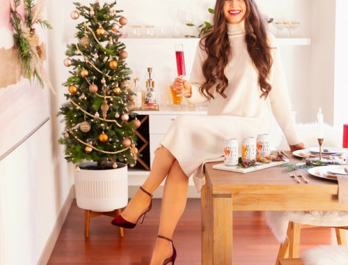 Easy Holiday Entertaining Ideas | Holiday Entertaining at Home | Stress Free Entertaining Tips | Holiday Cocktail Party | Easy Christmas Party Ideas | Simple Mid Century Modern Holiday Dinner Party | JustineCelina's Mid Century Modern Bohemian Dining Room & Bar | Brunette Woman Sitting on a Festive Dining Table Enjoying Berry Hibiscus Kombrewcha in a Champagne Flute | Kombrewcha available in Alberta | Kombrewca Review | Calgary Home Decor & Entertaining Blogger // JustineCelina.com