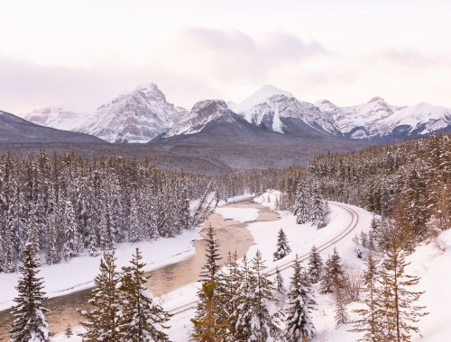 Hello 2020 | Morants Curve Photos | Morant's Curve Winter 2020 at Sunset | Bow Valley Parkway Winter 2020 | Bow Valley Winter | Highway 1a Banff to Lake Louise Lookouts | Canmore Scenic Drive | Best Things To do in Lake Louise Canada During the Winter | Getting to Lake Louise | Canadian at Morant's Curve | Snow Covered Canadian Mountain River Valley | The best winter scenic drives in the Canadian Rockies | Calgary Travel and Lifestyle Blogger // JustineCelina.com