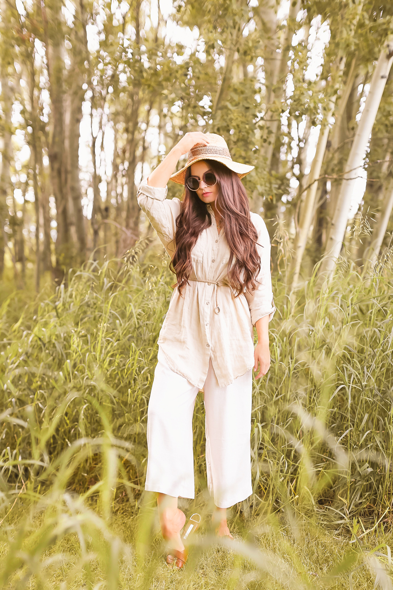 Summer 2020 Lookbook | Boho Summer 2020 Outfit Ideas | Summer Capsule Wardrobe | Summer Quarantine Outfits | Classic Summer Outfit Ideas | The Best Linen Pieces 2020 | The Best Affordable Linen Shirts and Culottes | Classic Linen Button Down Shirt | Summer Outfit Ideas | Classic Affordable Summer Style | Summer 2020 Trends | Brunette woman wearing a linen button-down shirt, H&M linen culottes and a straw hat in an Aspen tree grove | Calgary Alberta Fashion Blogger // JustineCelina.com