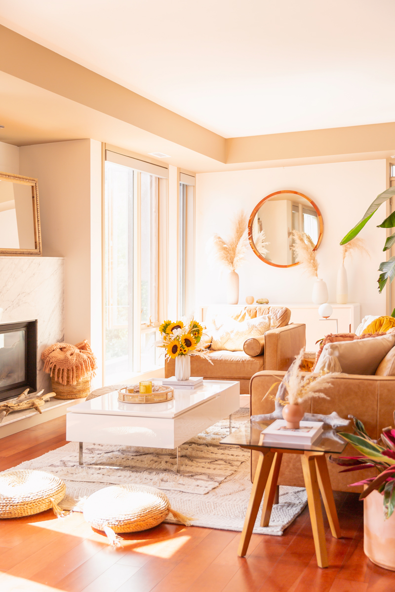 Transitional Summer Meets Autumn Decor | Summer to Fall Decor | September Decorations | Sunflower Decor | Easy Fall Decorating Ideas 2020 | Affordable Fall Decor | Simple Fall Decor Ideas | Fall Apartment Decor JustineCelina's Inner City Calgary bohemian, mid-century modern Living Room | Cheerful Sunflower Arrangement with Pampas Grass on a coffee table with 2 glasses of rosé | Structube Evo Coffee Table in Whitel | Sunflower Decor Ideas | Calgary Lifestyle Blogger // JustineCelina.com