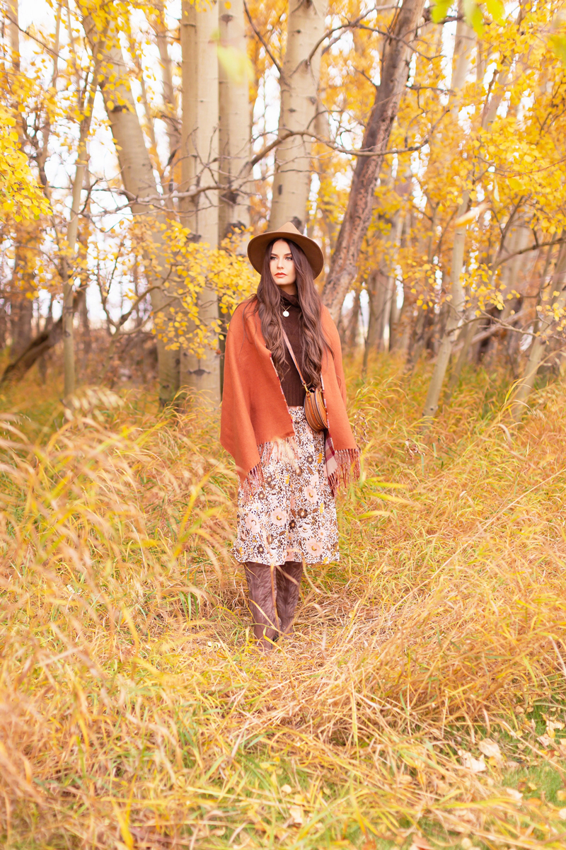 Fall 2020 Lookbook | A Lesson in Layering | Brunette woman wearing a fall floral midi dress, a brown turtleneck, a burnt orange shawl, brown western boots, a brown fedora and a round cognac crossbody bag amongst fall leaves | Boho Fall 2020 Outfit Ideas | Top Fall / Winter 2020 Trends | Bohemian Fall / Winter outfit Ideas | Cottagecore Fall / Winter Outfit Ideas | How to Style Midi Dresses into Fall and Winter | Creative Layering Ideas | Calgary Alberta Fashion Blogger // JustineCelina.com
