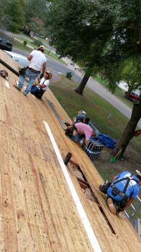 Just a few members of the crew we hired to reroof rental house #1 after the foundation work was complete.