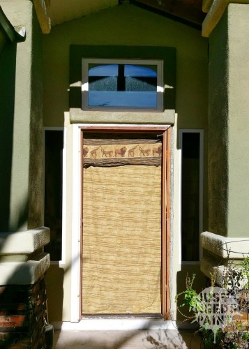A temporary front door with a sheet and a blanket keep the bugs at bay and kids inside.