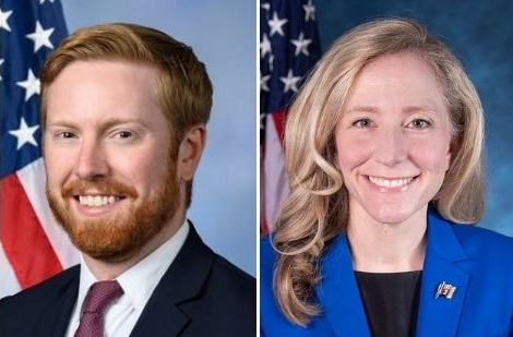 Side by side portrait photographs of Rep. Peter Meijer and Rep. Abigail Anne Spanberger. Both pose with an American flag behind.