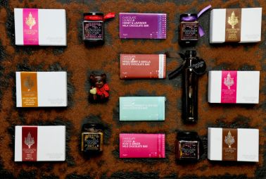 Chocolate lounge products photographed on slate with sprinkled chocolate.