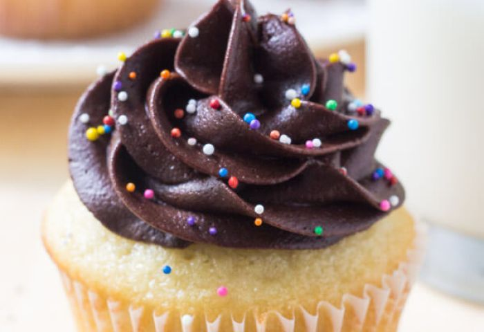 Vanilla Cupcakes With Chocolate Frosting Just So Tasty