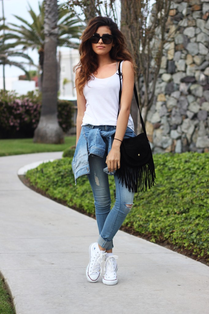 It is the season for skinny jeans and white Converse. Via Sazan Barzani Jeans: Black Orchid Denim, Tank Top: Zara, Denim Jacket: Topshop, Sneakers: Converse