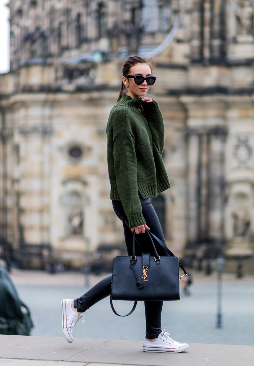 White converse can also make the perfect match to a knitwear look, like this stylish oversized bottle green sweater worn by Barbora Ondrackova with converse and leather leggings. Jumper: Asos, Leggings: Balenciaga, Sneakers: Converse.