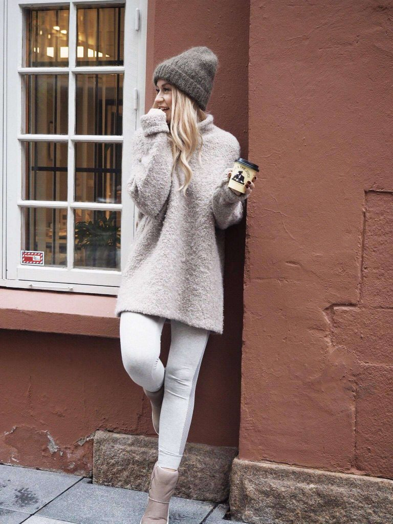Lene Orvik is sweet and Sunday chic in comfy boots and a creamy tunic sweater. A perfect example of athletic wear as lounge wear, these white leggings are versatile and adorable. Brands: Unspecified
