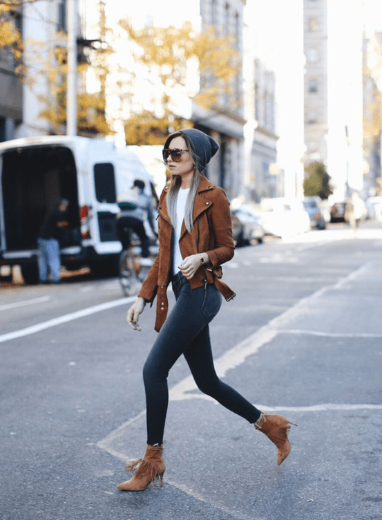 Danielle Bernstein is a vision in charcoal grey and camel. We love the way a simple fitted white tee accentuates the lavish hue of her jacket. Jacket: BAGATELLE.CITY