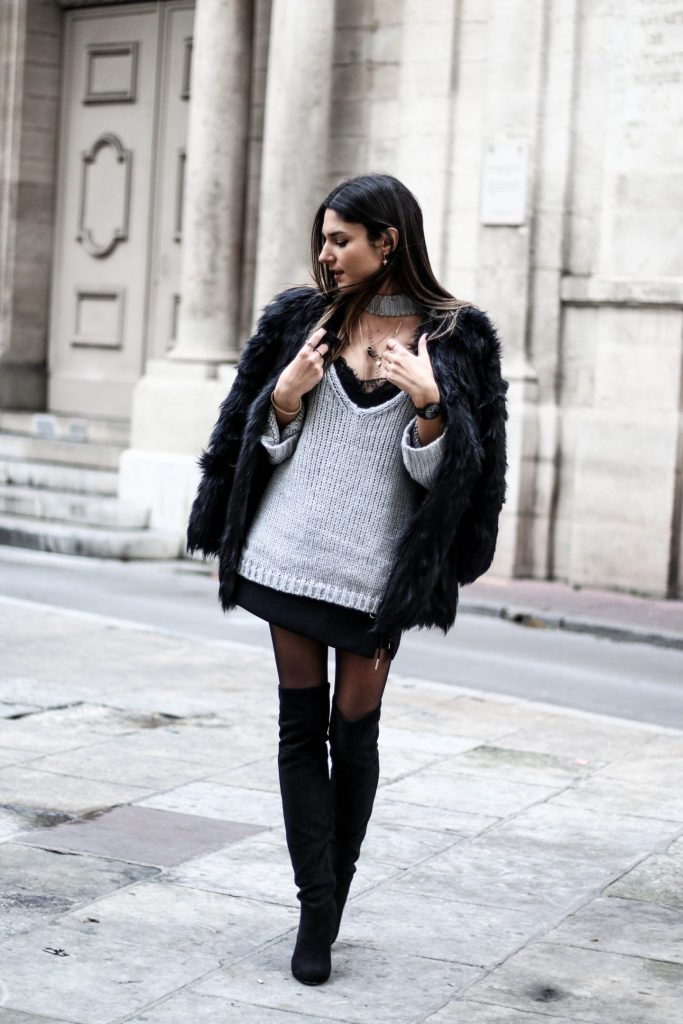 A lace undershirt, sheer black tights and layers of jewelry make this look cool and sensual. Black over-the-knee boots and a fur coat are essential statement pieces to incorporate into any winter wardrobe. Via Federica L. Sweater, Skirt & Jacket: Chicwish, Shirt: Stradivarius, Boots: H&M, Necklaces: Lily's Creations, Maria Pascual, Rings: Lily's Creations, Be Maad, Thomas Sabo, Watch: Klarf