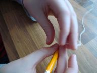 Step 6 Tie the string on a pencil