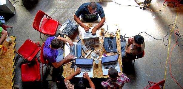 overhead techies working together JUUCHINI