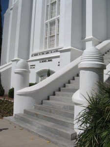 Entrance to the St. George (Utah) Temple, with beehives on the newel posts at the foot of the main stairs.